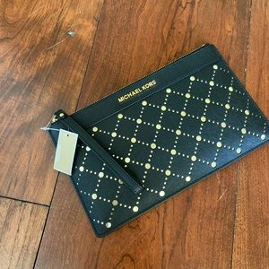 NWT Michael Kors perforated Leather wristlet black